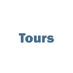 """White circle with blue writing """"Tours"""""""