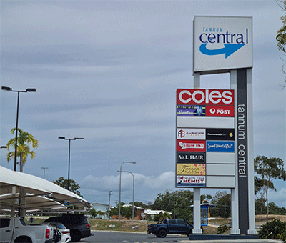 Coles Central sign at parking lot with Coles and post office signs