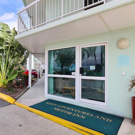 Reception door with door mat displaying Reef Adventureland Motor nn