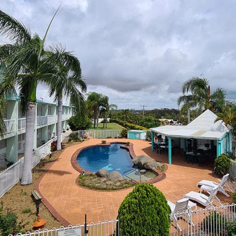 Elevated view of pool, garden, barbeque hut and motel rooms