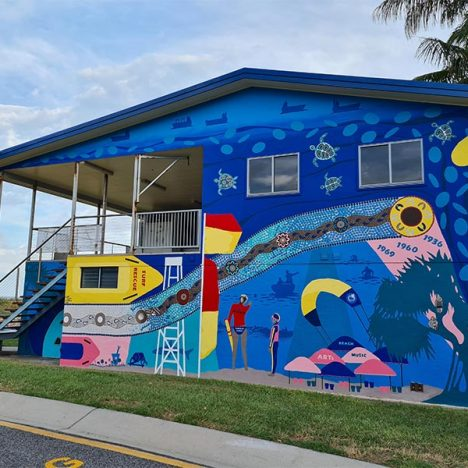 Tannum Sands Surf Club Wall with brightly painted mural with blues yellow red and pink